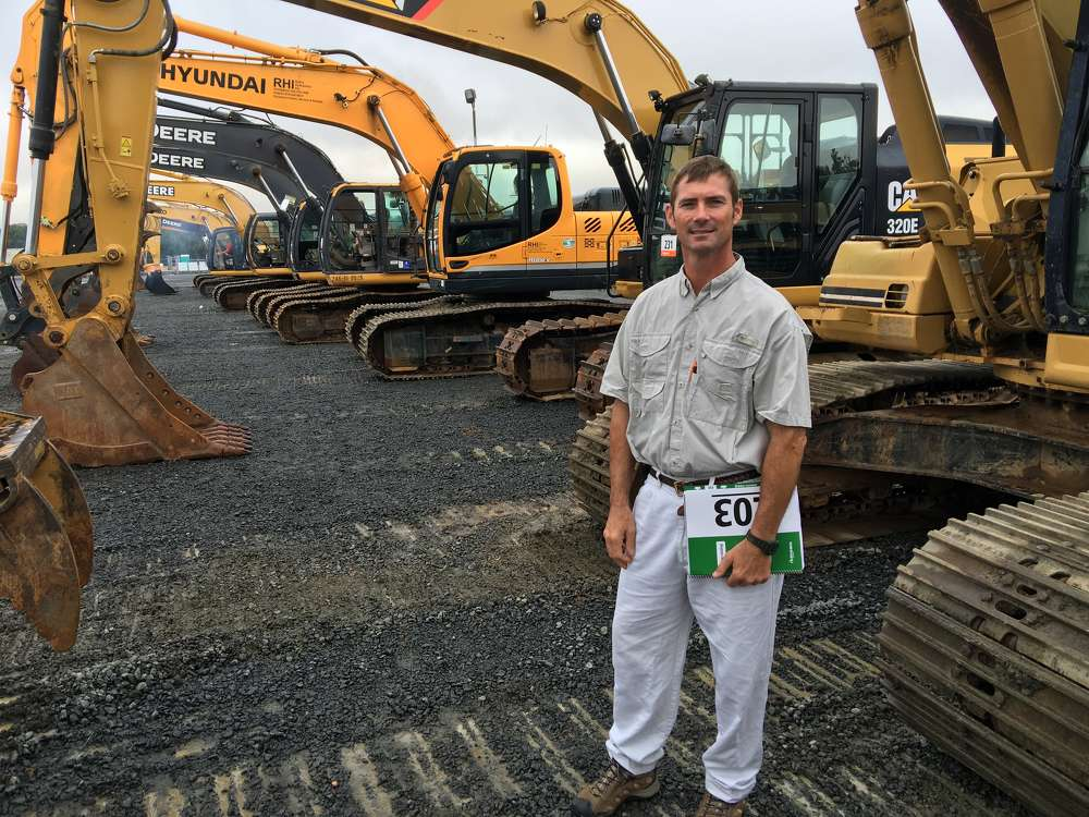 Scott Tulloss of Tullos Equipment Company in Rocky Mount, N.C., looks over the Cat, Hyundai and John Deere excavators.