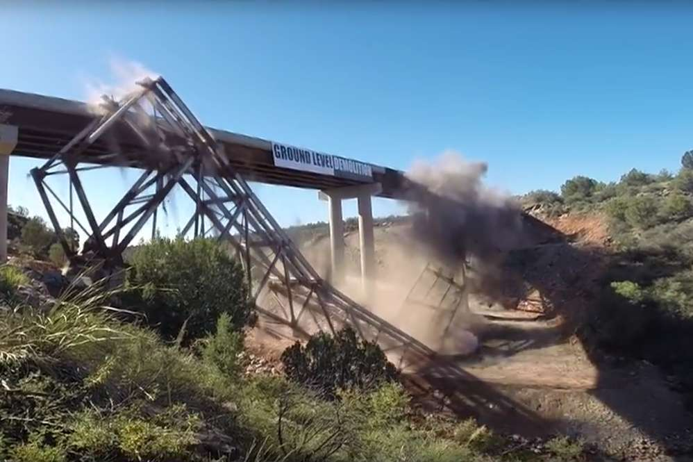 ADOT photo. Contractors used an implosion technique that caused the bridge girders to melt and allow the structure to collapse onto itself.