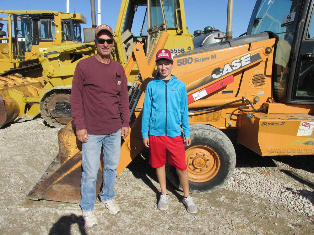 Joe Rod (L) of Joe Rod Services in Bowie, Texas, decided to bring his son, Justus, with him to see about this Case 580 Super M backhoe.