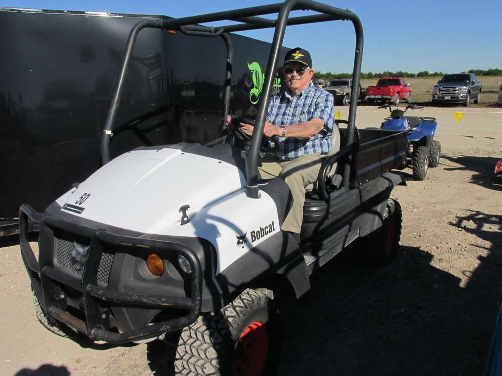 Frank Saunders, an independent contractor in Anna, Texas, gives this Bobcat utility vehicle a tryout.