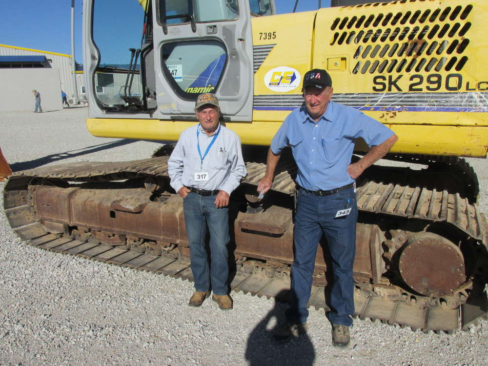 Jerry Thompson (L) and his brother, Gary, G.N. Thompson Inc. of Granbury, Texas, are ready to bid on this Kobelco SK 290 excavator.