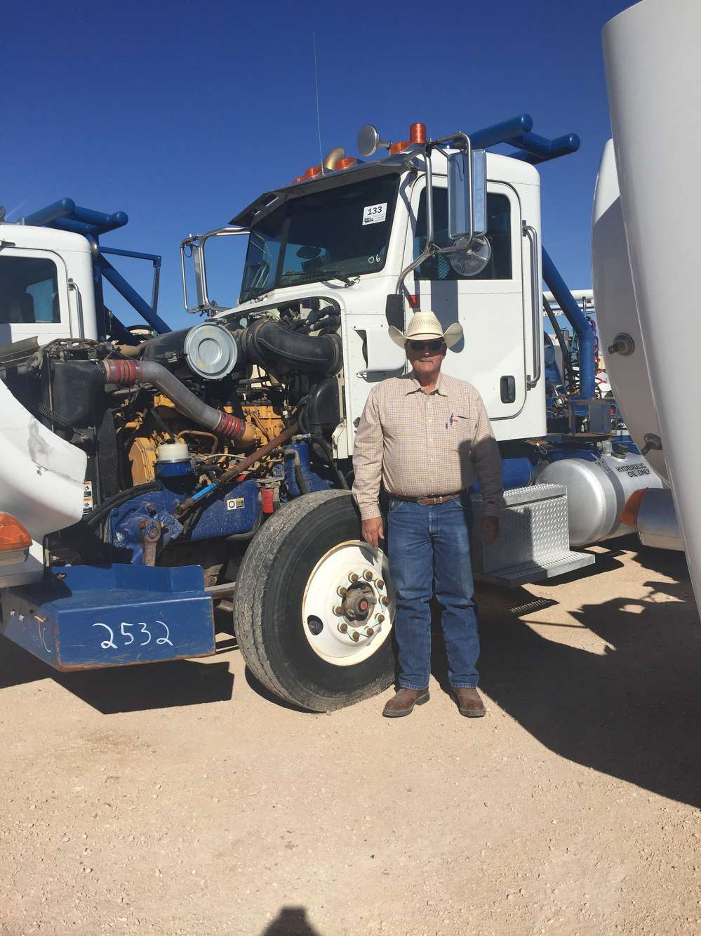 Steve Murphy of Bonham, Texas, inspects one of the many truck tractors sold in the Stanton, Texas, auction.