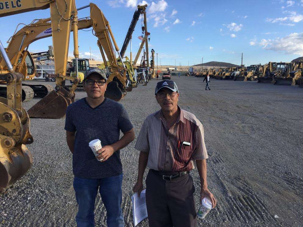 Tai Tran (L) and Miller Tran came from California in search of Bobcat skid steers. They bought three in the first hour of auction.