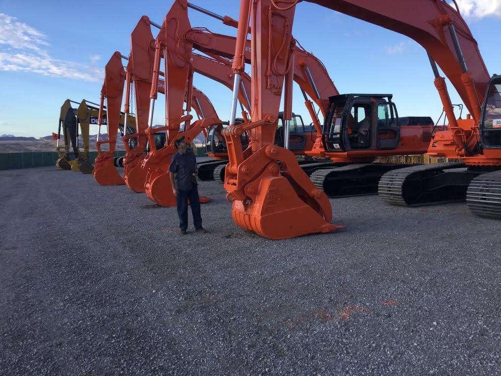 Steve Pokrajac, owner of Pokrajac Construction, Monrovia, Calif., checks out the selection of Hitachi excavators.