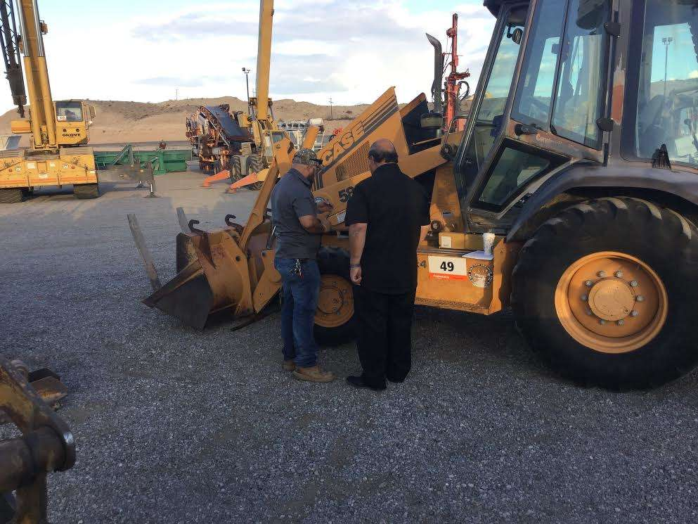 David Guevara (R) and his son, Rene, check out this Case 580 backhoe for their business, Guevara Construction of El Monte, Calif.
