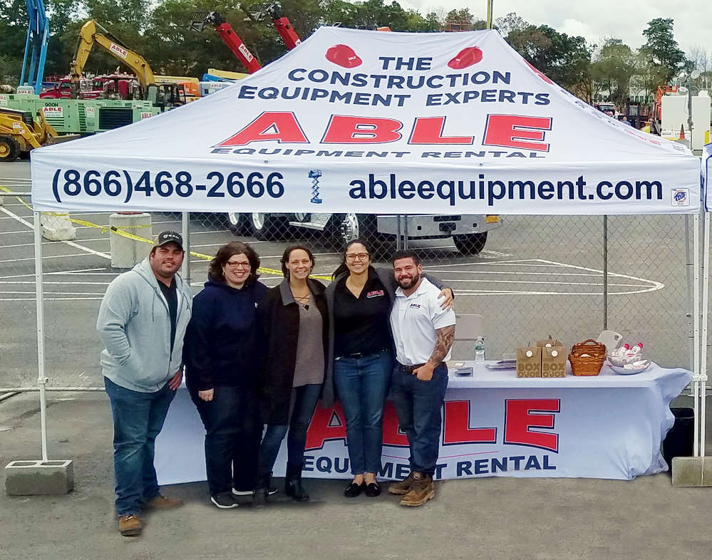 (L-R): Dino Kalogeropoulos, Annisa Earvolino, Mindi Parrott, Monica Hagberg and Ian Garfinkel, all ABLE associates, greet customers at the open house event.