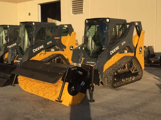 Several compact equipment units were on display, including this John Deere 317G compact track loader with a broom.