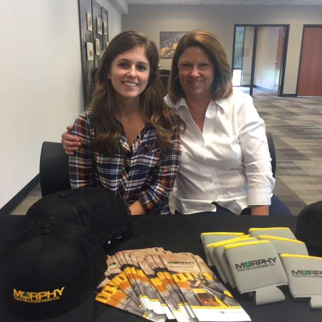 Katie (L) and Laura Riley helped customers register for all the wonderful door prizes.