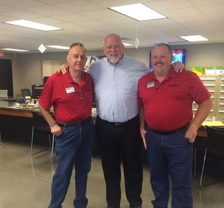 Craig Wolfley (C), former Pittsburgh Steeler and Minnesota Viking, came to the open house to greet customers. He also talked with Claude Bynum (L) and Alan Frederick, Murphy Tractor parts representatives. Wolfley podcasts weekly on The Craig Wolfley Podcast.