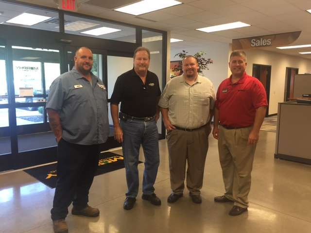 Sean Riley (R), Murphy Tractor area sales manager, welcomes customers to the grand opening.