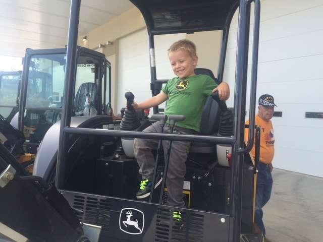 Future customer Joey Ciz has a blast in the mini-excavator.