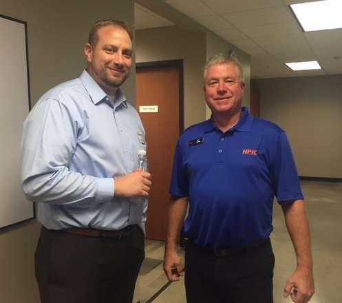 Adam Karsten (L), Murphy Tractor general sales manager-compact equipment, and NPK representative Ken Skala.