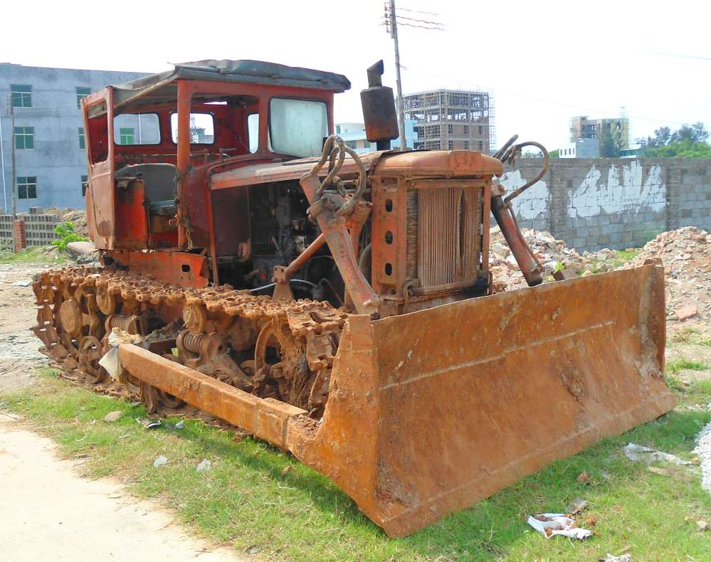 Anna Frodesiak photo.  An early model (First Tractor Company) tractor, still operational, in Xinbu Island, Hainan Province, China.