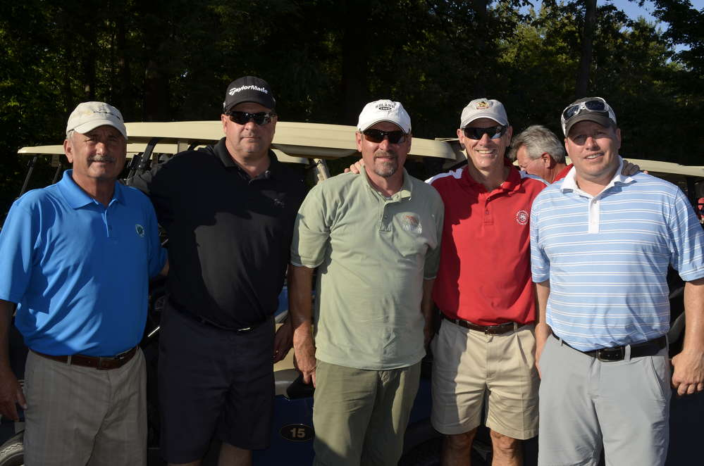 (L-R) are Joe Rizzo, Upstate Paving; Dave Gates, Broome Bituminous Products; Don Basley, D.A. Collins; and Dave Perry and Mike Courchaine, both of Milton CAT.