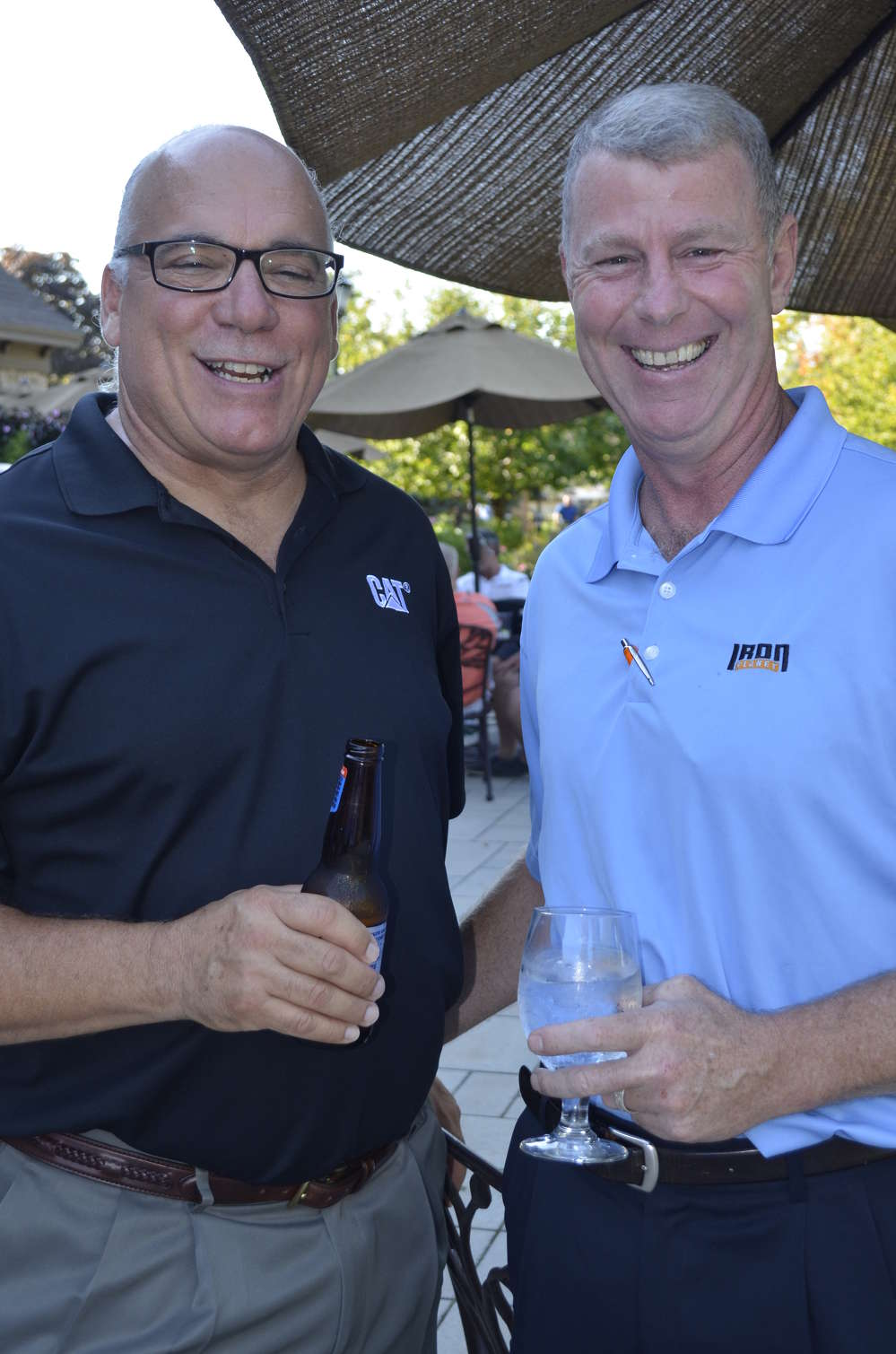 Milton CAT's George Maggiolo (L) catches up on industry trends with IronPlanet's Tim Delaney.