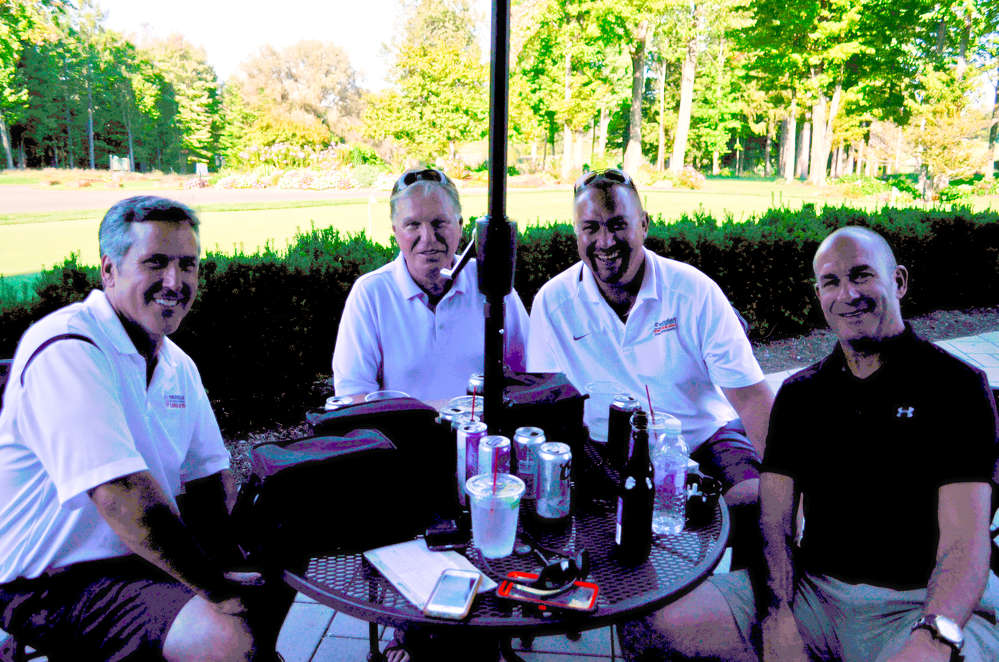 Enjoying a libation after a rigorous round of golf (L-R) are Tom Kinsella, Kinsella Industries; Jerry Tracey, Tracey Road Equipment; Jason Green, Saunders Concrete; and Greg Rinaldi, Superior Seal and Paving.