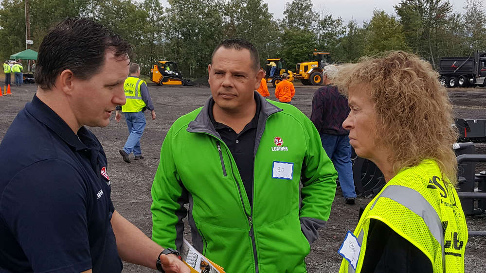 Stephenson's JCB representative. Stacie Prest (R) talks with Damian Florian (L) and B J Sotko of 84 lumber about their thoughts on the JCB event, and the JCB machines that they demo'd.