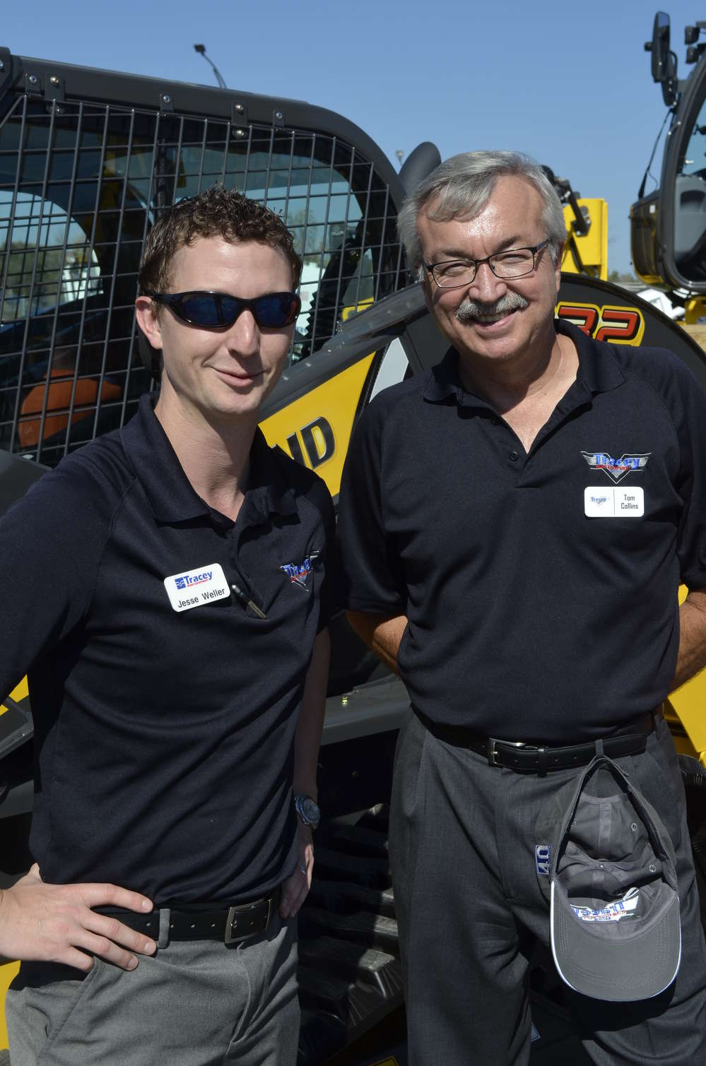 Jesse Weller (L), inside sales, and Tom Collins, Tracey Road Equipment used equipment manager, are ready to assist customers who wish to purchase a New Holland skid steer.