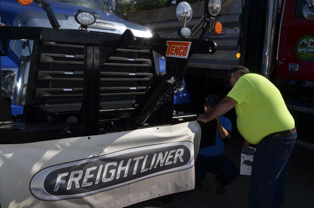 Pat Steger, highway superintendent of the town of Niles, takes an up-close look at a Freightliner truck with Glen Plaisted, factory representative of Freightliner.