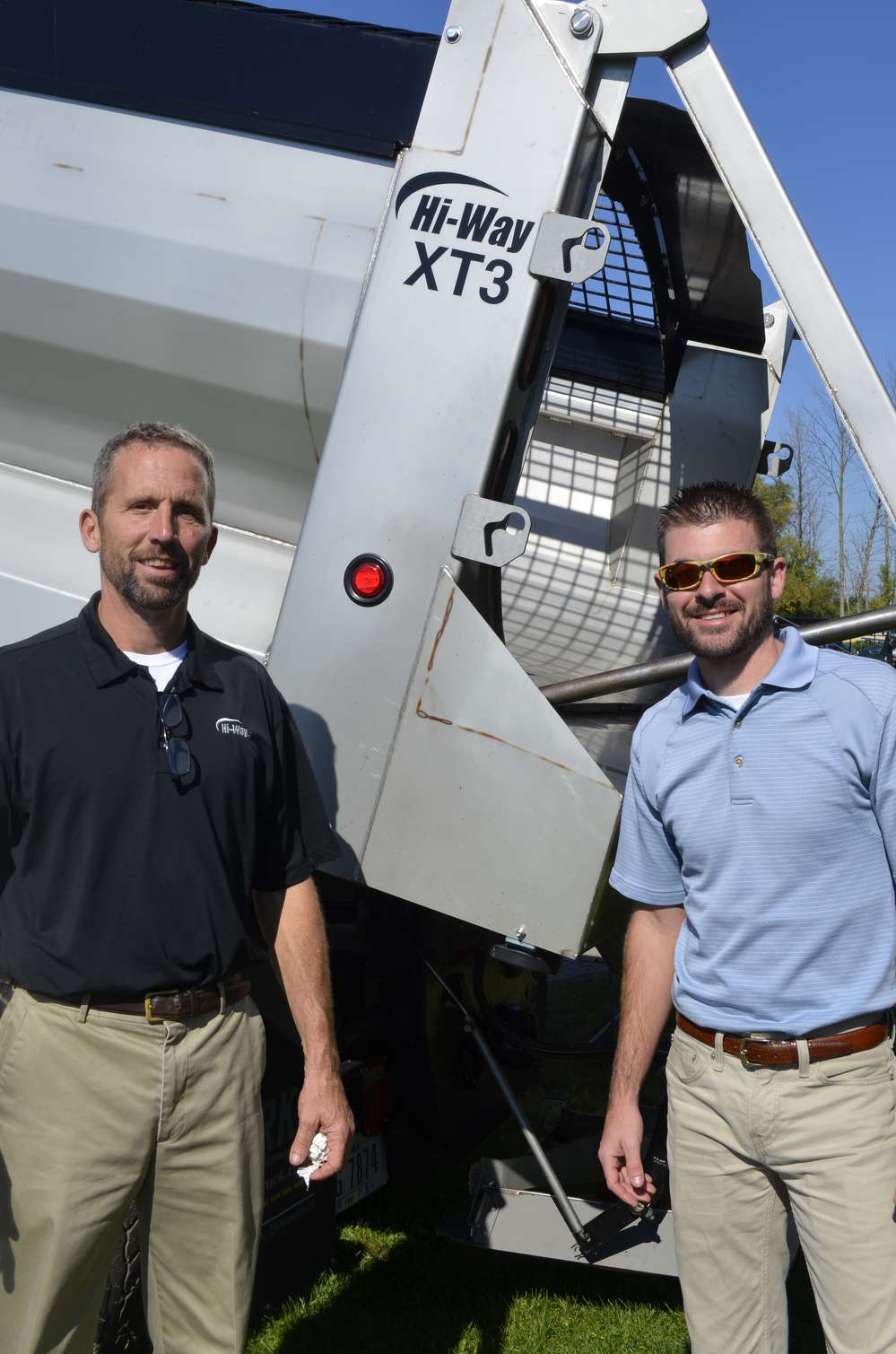 Tom Krick (L) and Zack Rissey of Hi-Way Equipment show off the new XTS dual auger body that offers better clean out, less carry over and lower maintenance.