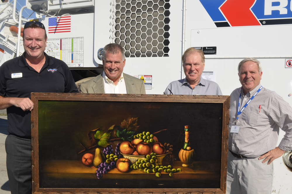(L-R): Scott Collins, Tracey Road Equipment; Scott Chenet, Barton and Loguidice; Jerry Tracey, president and owner of Tracey Road Equipment; and Jeff Hanion, Slate Hill Contractors, show off this beautiful velvet painting that will be proudly displayed in Jerry Tracey's office for the next year.