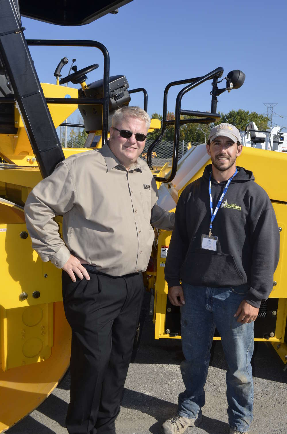 Mark Armel (L) of Sakai discusses compaction and density with Alex Dewitt of the town of Onondaga.