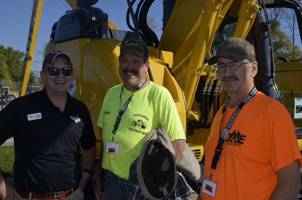(L-R): Travis Marshall, Tracey Road Equipment; Brad Hotaling, highway superintendent of the town of Pitcher; and Brian Delee, of the town of Pitcher, check out the features of a Kobelco SK140SR.