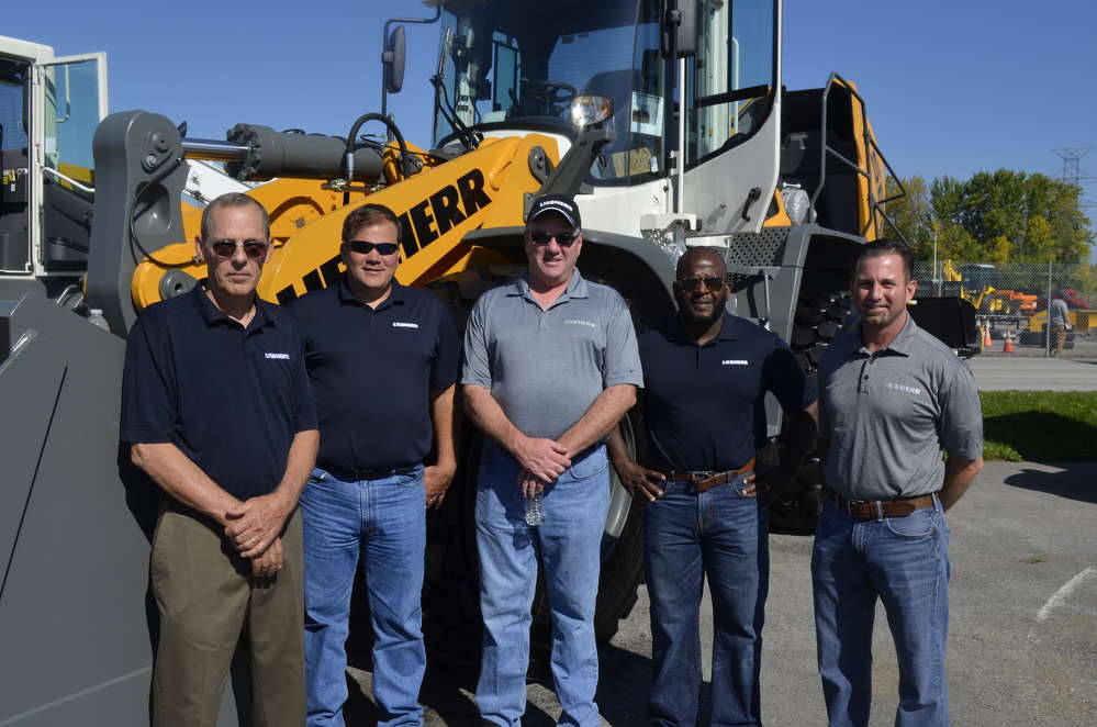 (L-R): Ken Cunningham, Alan Petry, Kevin Murphy, Marcus Barnes and Jason Brady, all of Liebherr, present the new Liebherr 566X wheel loader equipped with a new hydrostatic power shift transmission.