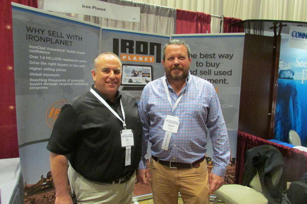 Rick Person (L) and Scott Smith, both territory managers of IronPlanet, are ready to discuss upcoming online auctions with UTCA convention guests.
