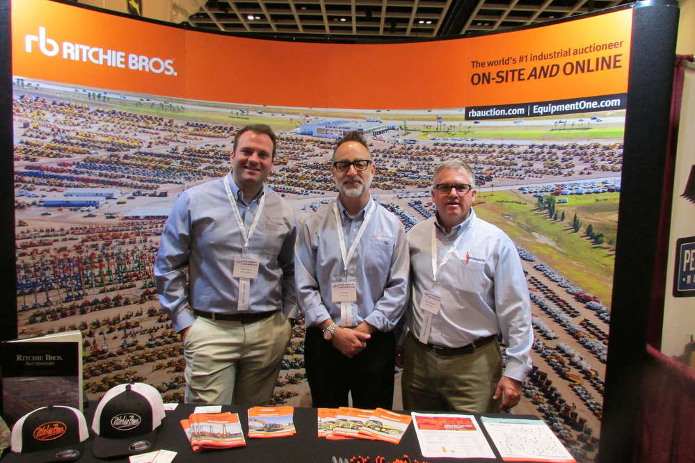 Manning the Ritchie Bros. booth at the UTCA convention to discuss their company's extensive list of upcoming auctions (L-R) are Ryan Funck, Gary King and Fred Vilsmeier.
