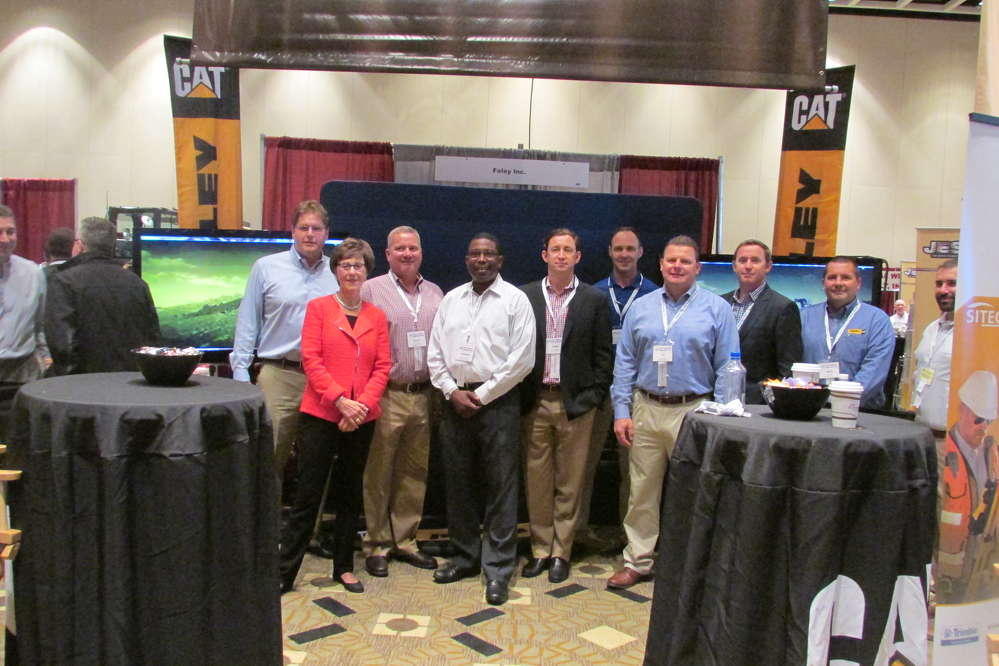 Representing the Foley CAT booth (L-R) are Jeff Merle, vice president of machine sales; Susan Connolly, COO; Scott Warren, heavy account manager; Warren Gonzalez, heavy account manager; Jamie Foley, CEO; John Lewis, SITECH representative; Ed Gudaitis, vice president of Foley Rents; Ryan Foley, president; Pete Reis, Foley Rents account manager; and Brian Vigilante, Foley Rents sales manager.