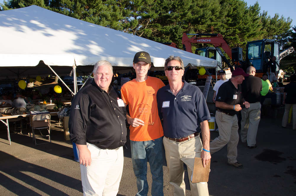 Tom Lawlor of Tom Lawlor & Son won 1st place in the pick-up division of the truck show with his 1977 Ford F-150.  (L-R) are Mark Hansen, vice president of product support; Tom Lawlor; and Rob.