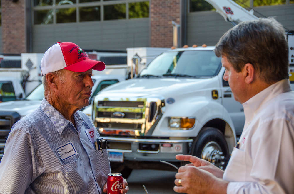 "William ""Bill"" Dufford (L), founder of Riverview Farms in Glastonbury, Conn., and Doug Hansen, president of W.I. Clark Company, were enjoying catching up at the customer appreciation day."
