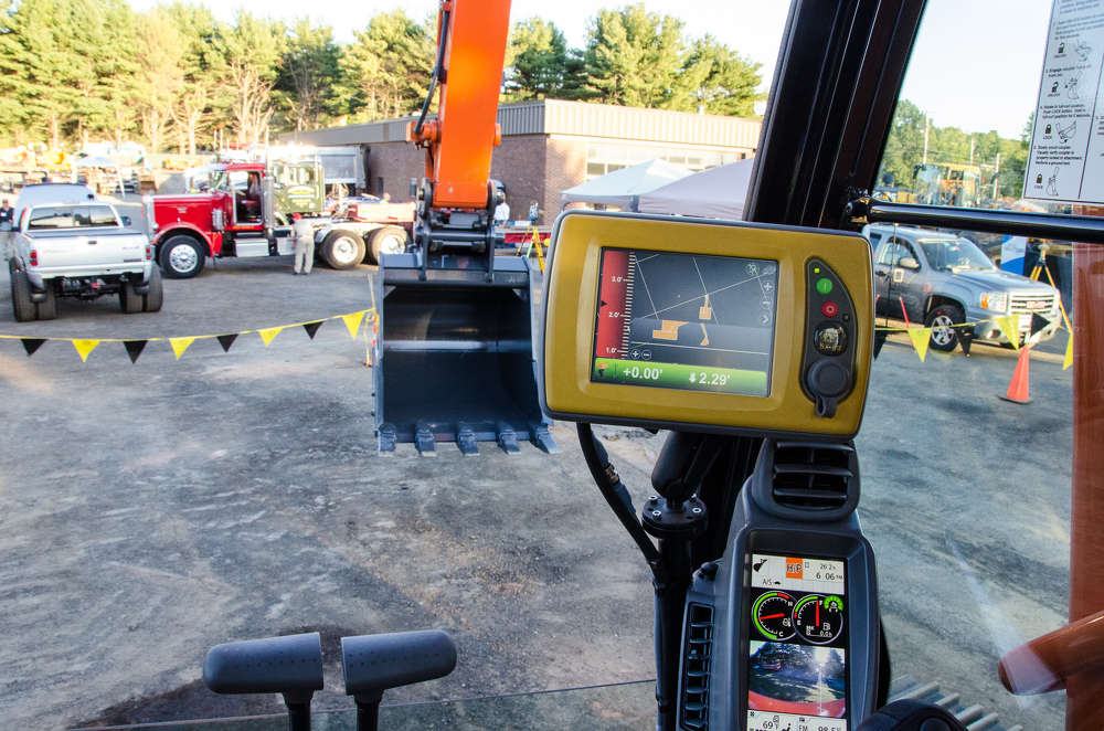 An inside view of the cab of the Hitachi excavator sporting the Topcon GPS technology.