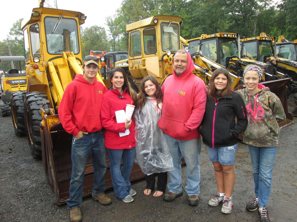 Steve Boucher (third from R), owner of SAB Tree Experts, Franklin, Conn., came to the auction with his family — son Stephen, daughters Tisha, Taylor and Megan and family friend Zayla McLean.