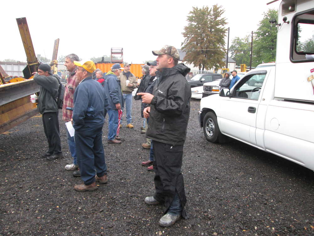 Sales Auction Company Manager John Stevenson acknowledges bids in front of an auctioneer truck. Stevenson was one of two auctioneers taking bids all morning, due to the large volume of equipment at the Oct. 1 event.