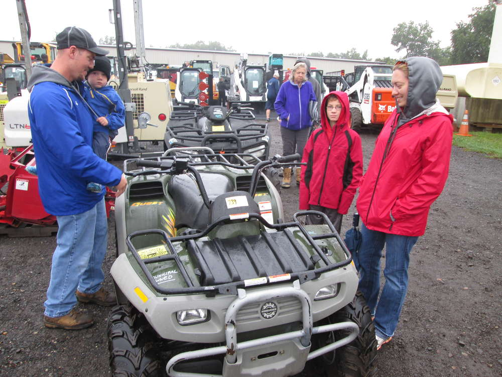 Many families attended the Sales Auction Co. fall sale on Oct. 1, including Josh and Ashley Thompson and their sons Johnny (in his father's arms) and Austin of Windsor Locks, Conn. Josh works for Evergreen Tree Service.