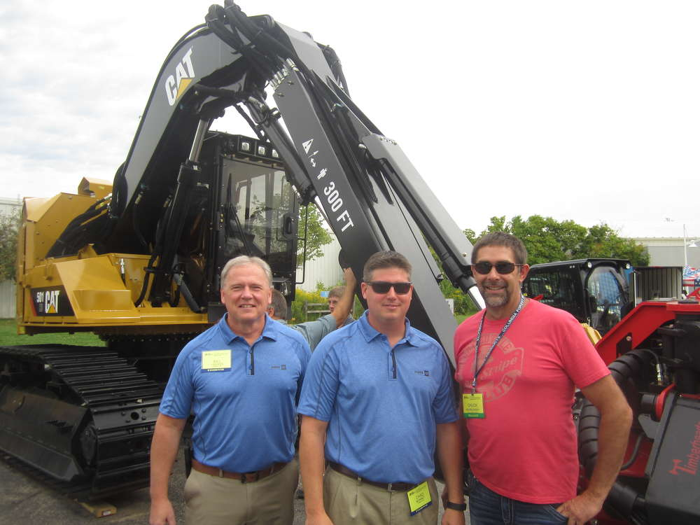 (L-R): Bill Linssen and Chad Monnet, both of Fabick CAT, welcome Chuck Barnowsky of Lake Shore Forrest Products.