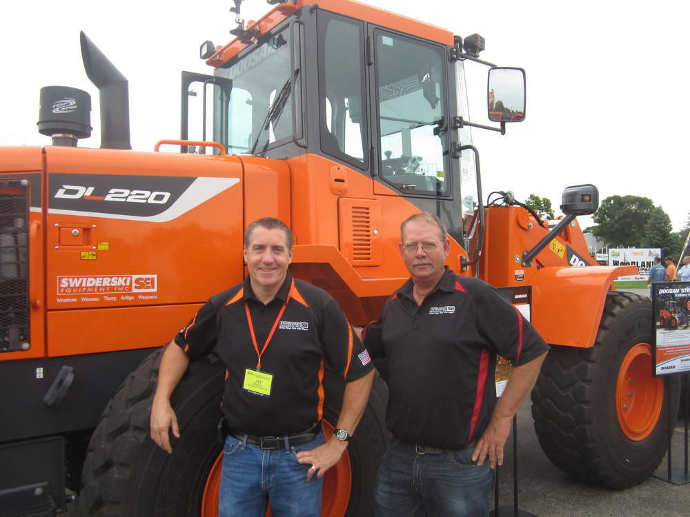 Jim Barry (L) and Ron Ison, Swiderski Equipment Co., display this Doosan DL220 series 5 high lift loader at the expo.