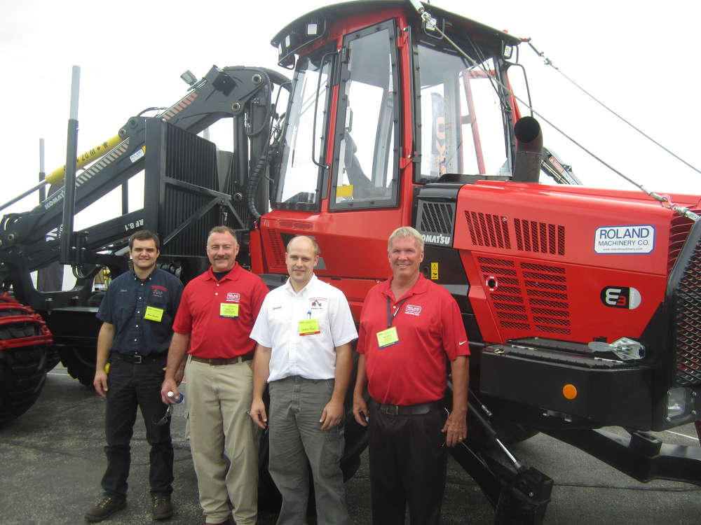 (L-R): Steve Kreider, Bridge Creek Logging LLC; Brett Anderson, Roland Machinery Co.; Wendell Risser, Bridge Creek Logging LLC; and Perry Hughes, Roland Machinery Co., stand in front of the Komatsu 855.1 forwarder.