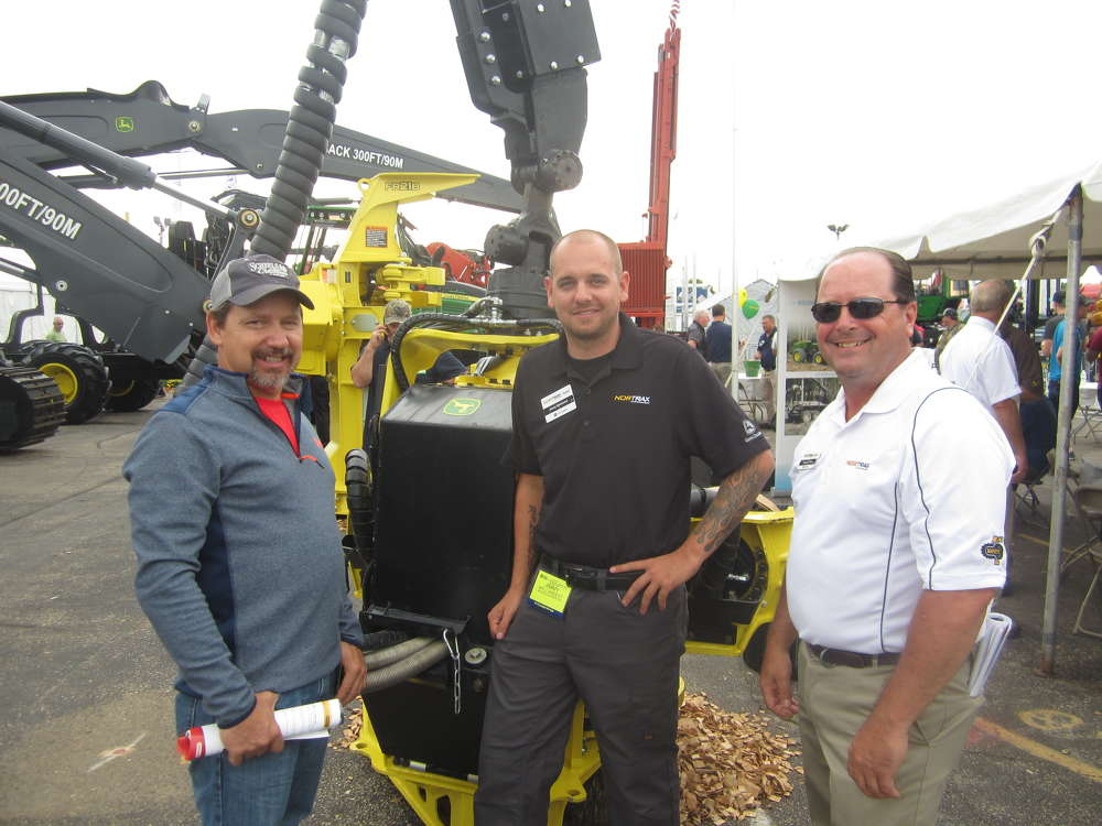 (L-R): Steve Piwarski, Piwarski Brothers Logging, stops by the Nortrax display area manned by Jimmy Mylchreest and Randy Stone, both of Nortrax, to see the John Deere 1270G harvester equipped with a H415 head.