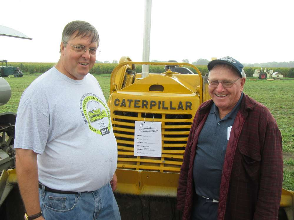 In from western Pennsylvania, Walt Garrison (L) of Cranberry Township and Jack Kaltenbaugh of Butler admire a 1953 Cat HTC4, similar to one Kaltenbaugh used to operate on the job.