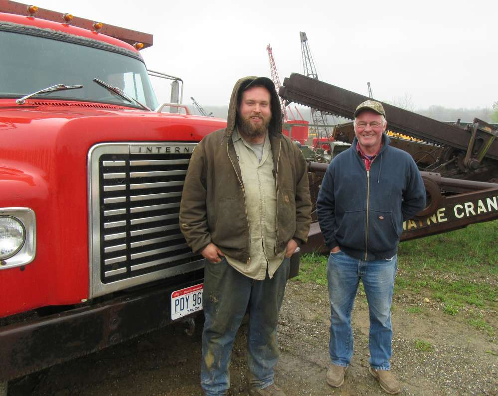 Andy Paterek (L), Lakeside Sand & Gravel, and his father, Fran Paterek, display Andy's 1973 International 1800 loadstar at the event.