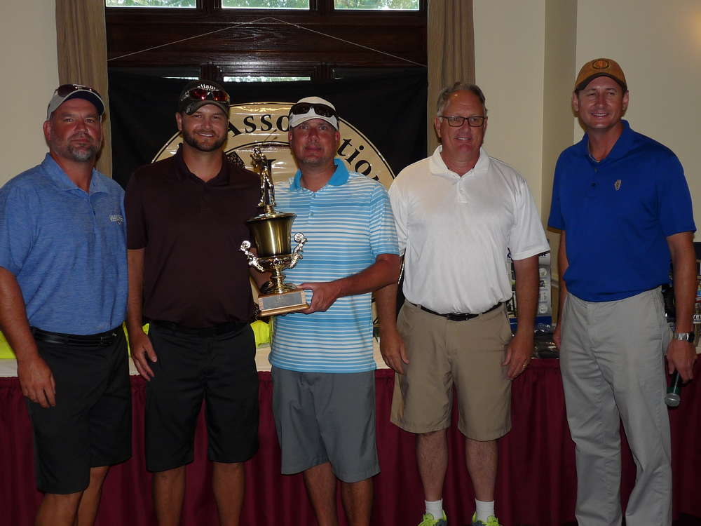 Accepting the first place trophy was the Central Stone team, including (L-R) Dustin Pollit, Heath Otte and Darin Roland and Hugh Gallivan, IAAP president, and  Dan Eichholz, executive director.