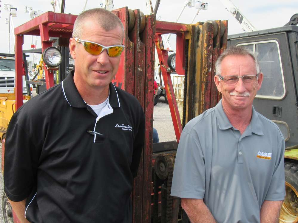 Jerry Rice (L) and Gary Arthur, Southeastern Equipment, keep an eye on the prices at the auction.