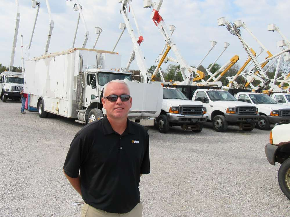 Brian Pike, account manager of Altec Industries, attends the auction.
