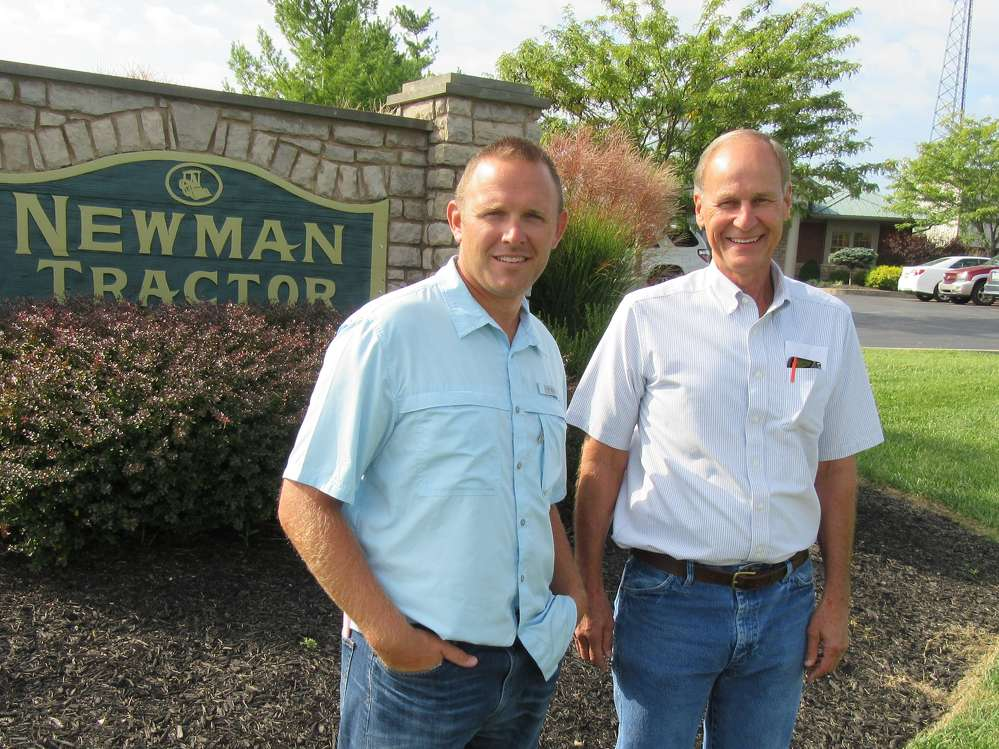 Scott Harmeling (L) and Rick Newman, both of Newman Tractor, welcome J.J. Kane to their facility for the auction.