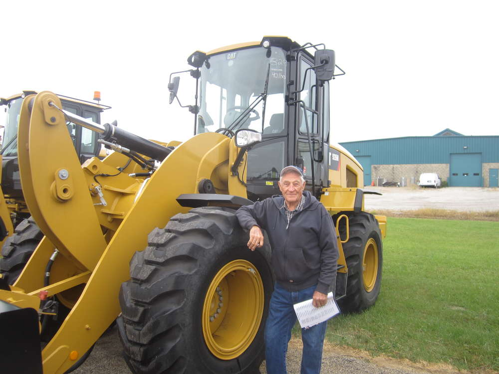 Thomas Pattermann, owner Tom's Equipment Inc., checks the tires of