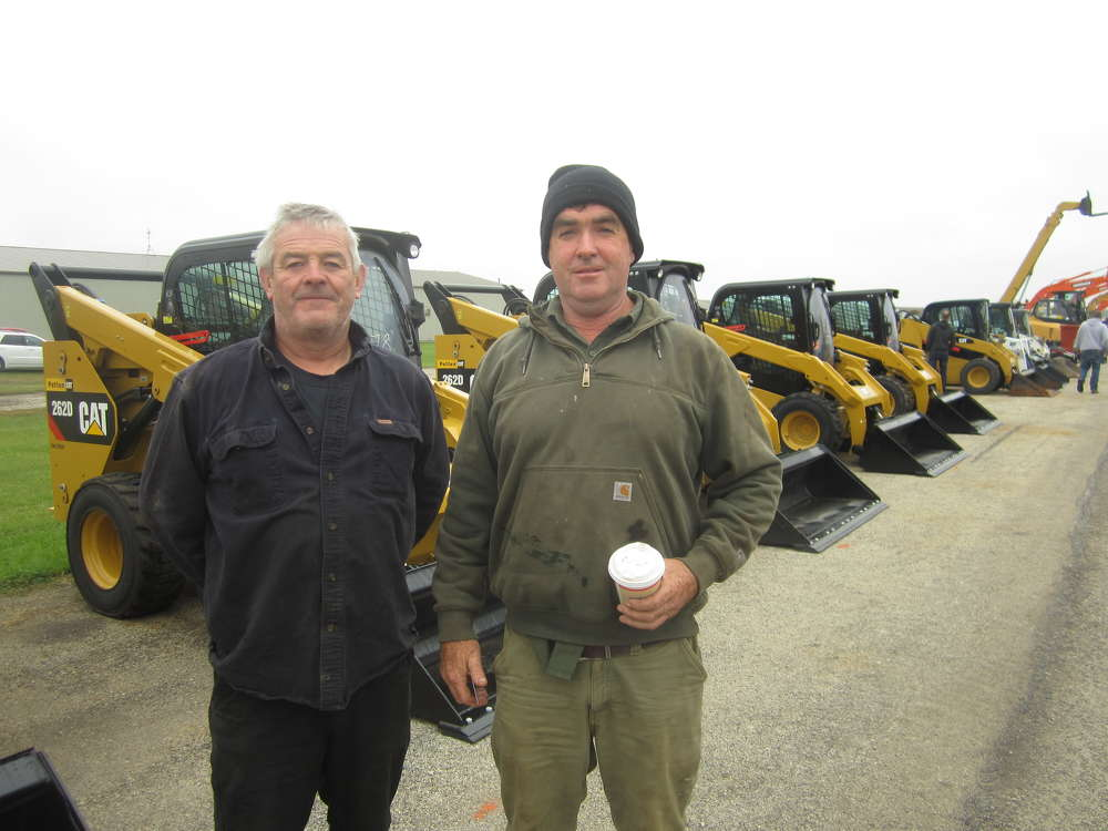Jack Maloney, Merc Group LLC, and John O'Neill, owner O'Neill Excavating, shop the selection of Cat machines.