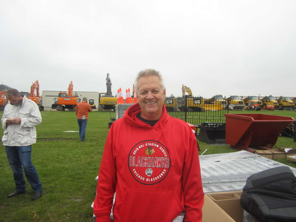 Randy Strait, owner Arctic Snow & Ice Control, looks through the different lots at the auction.